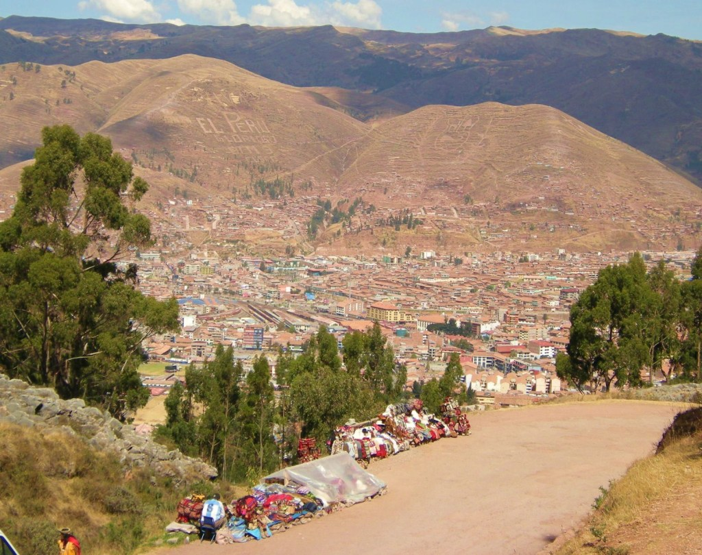 And of course, where there are ruins, there are tourists...and where there are tourists there are vendors with native trinkets for sale! In this picture you can see how close we still were to Cusco.