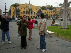 Plaza de Armas: Sheila (our city tour guide) explains while group members take pictures.