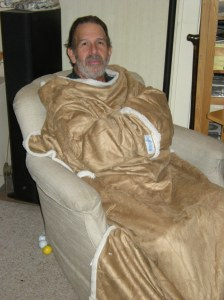 "Day after homecoming! Relaxing in his ""snuggie"" (A Christmas present)"