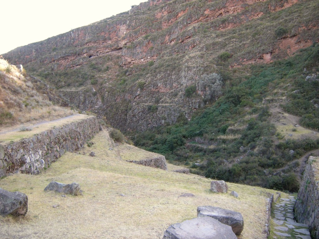 From this view can be seen burial holes, overgrown terraces, and the aqueduct system (lower right)