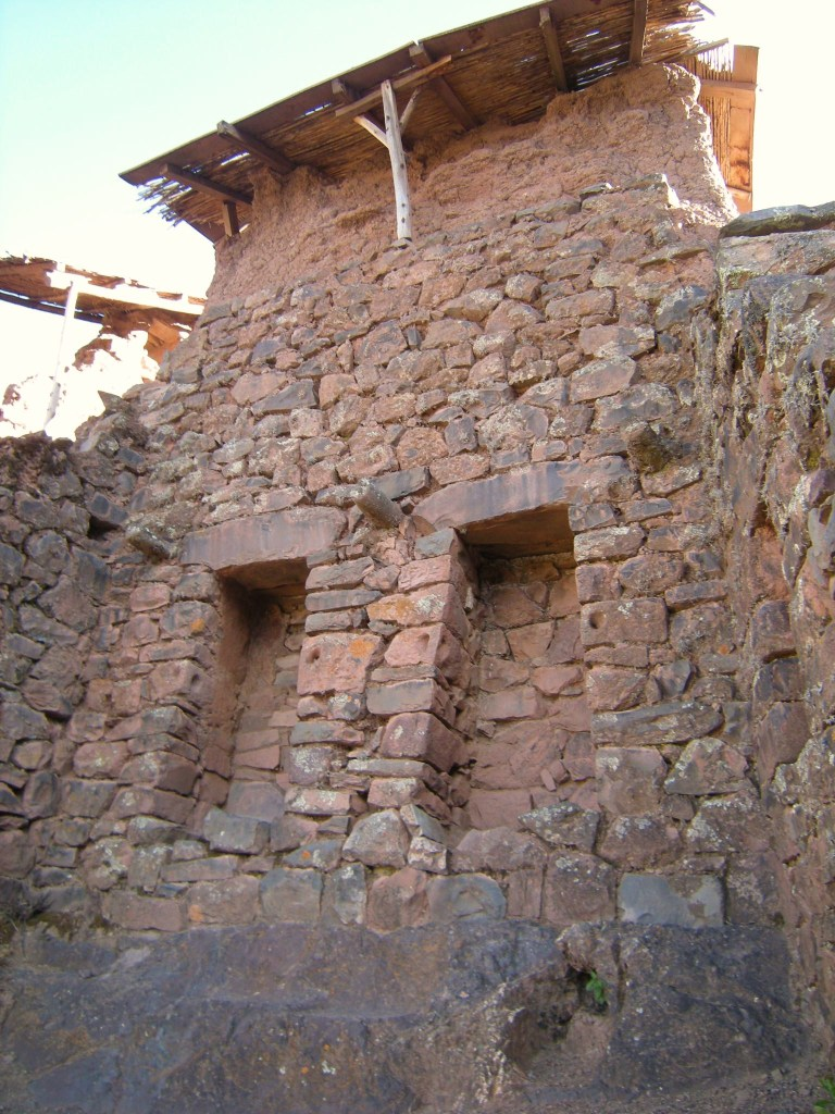 trapezoidal niches in pirka stonework (possibly for idols in people's houses) with roof supports