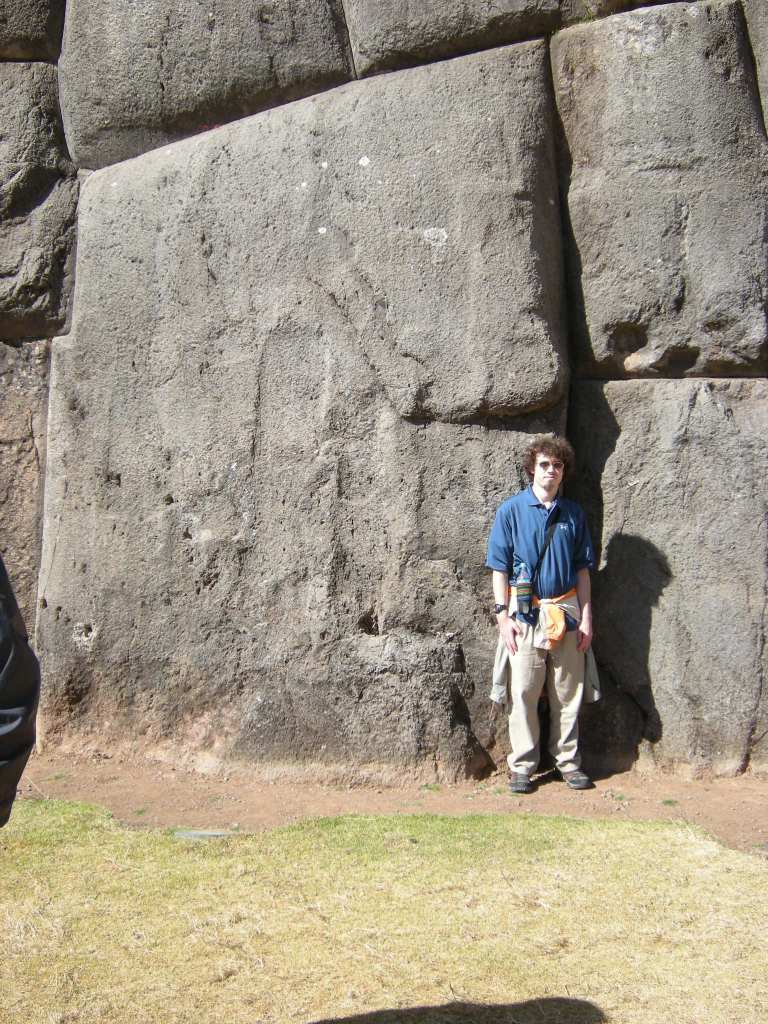 "This is my son standing next to one of the larger boulders. He's about 5'8"" which gives an idea of how massive they are."