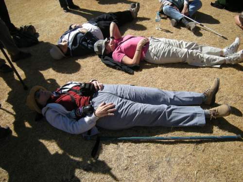 Group members lie on the ground to rest - OAT tours pack a very full schedule every day!
