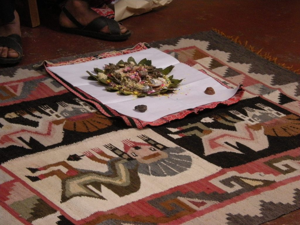 Ceremonial preparation includes coca leaves and other plant material