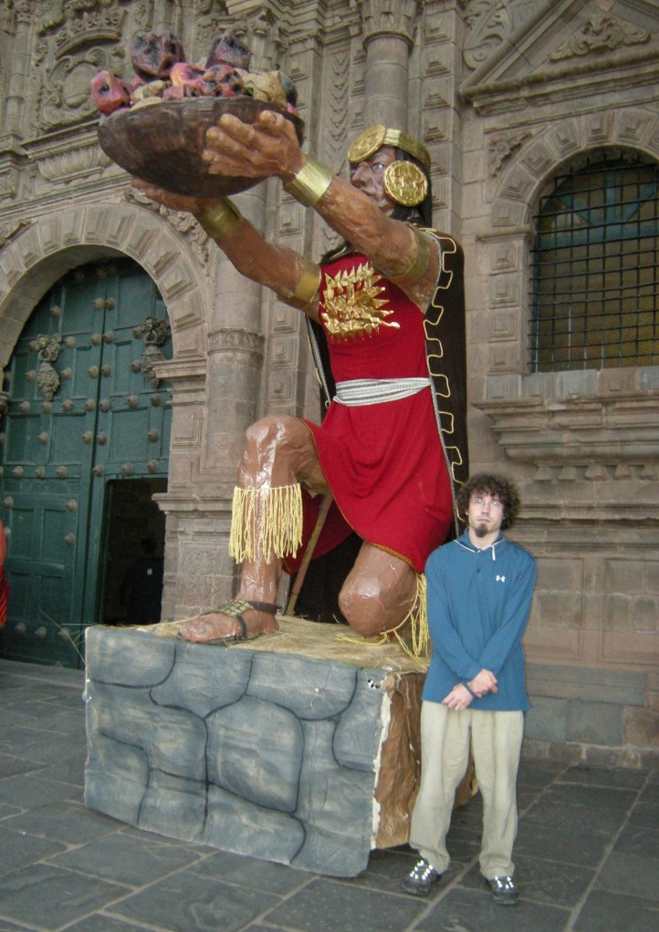 This statue was left over from  Inti Raymi, festival of the sun god. My son Jayme poses next to it.
