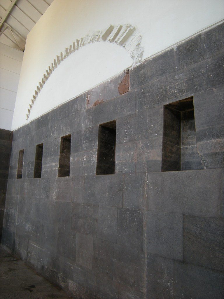 When they stripped this facade (the remainder of it in white above), they found a beautiful intact Inca wall.