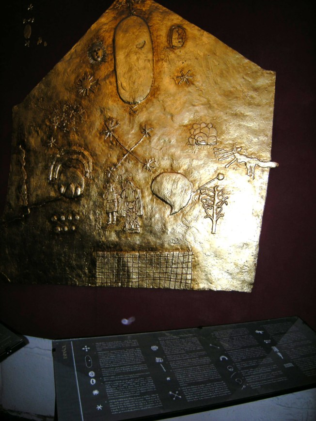 The images on this gold plate are explained in the next picture.