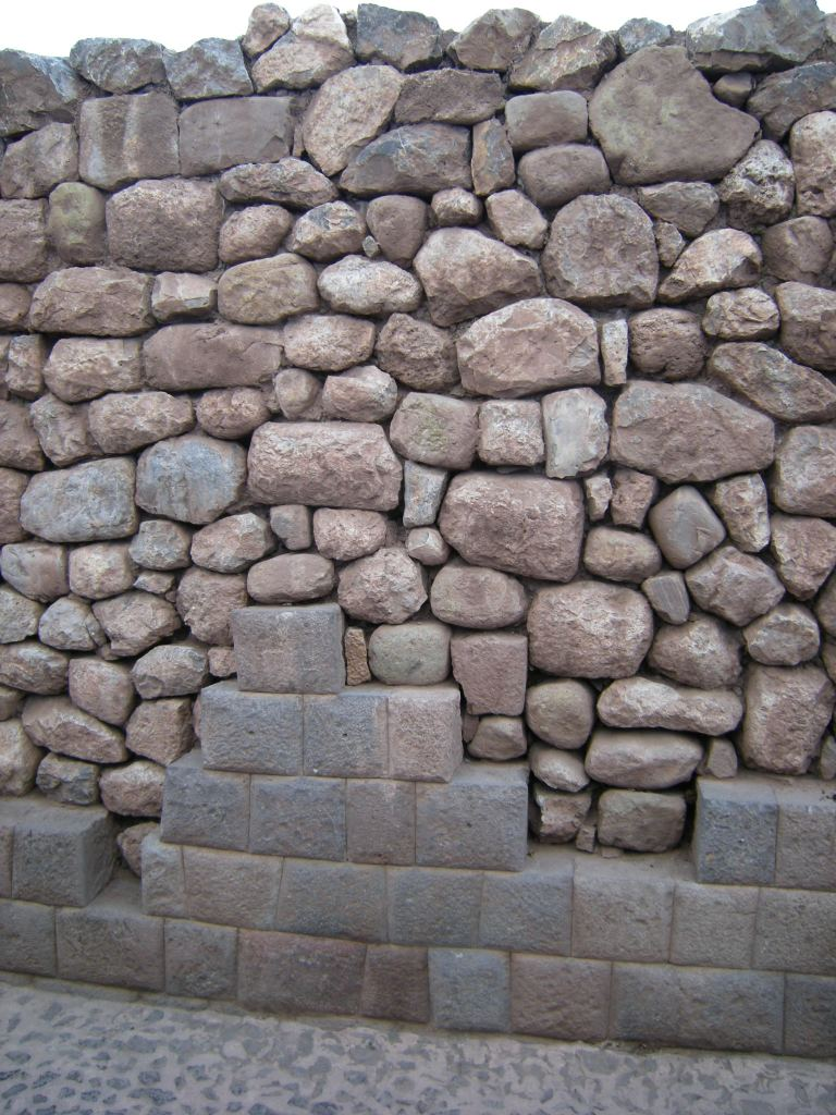 This stone wall was filled in, only the bottom of the Inca wall remaining.
