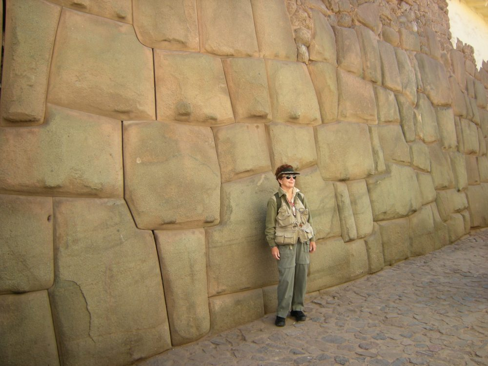 Pat stands in front of preserved Inca wall in Cusco