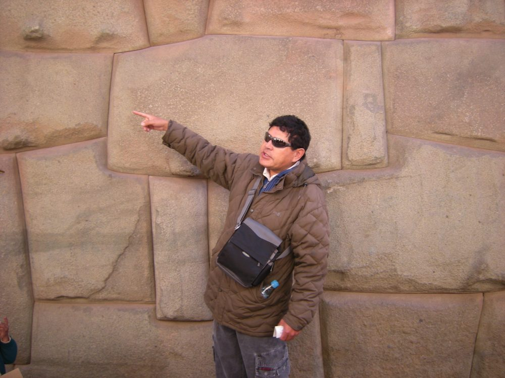 Boris points out features of another Inca wall with fitted stones creating pictures.