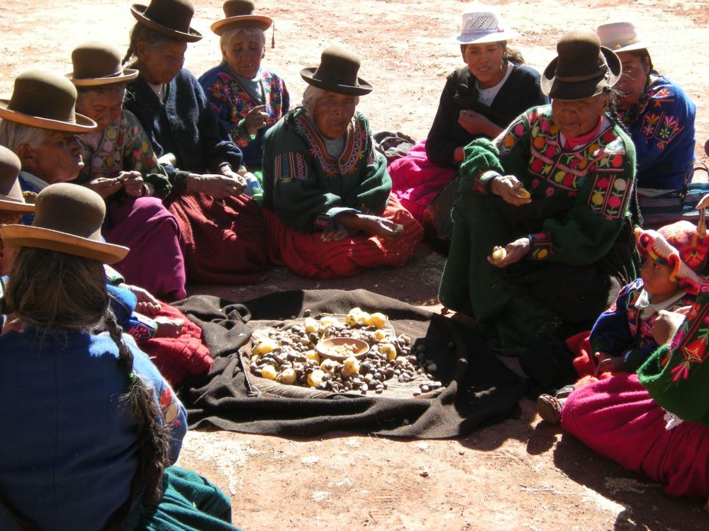 Rural villagers in southern Peru share a meal of mostly potatoes, their main staple.