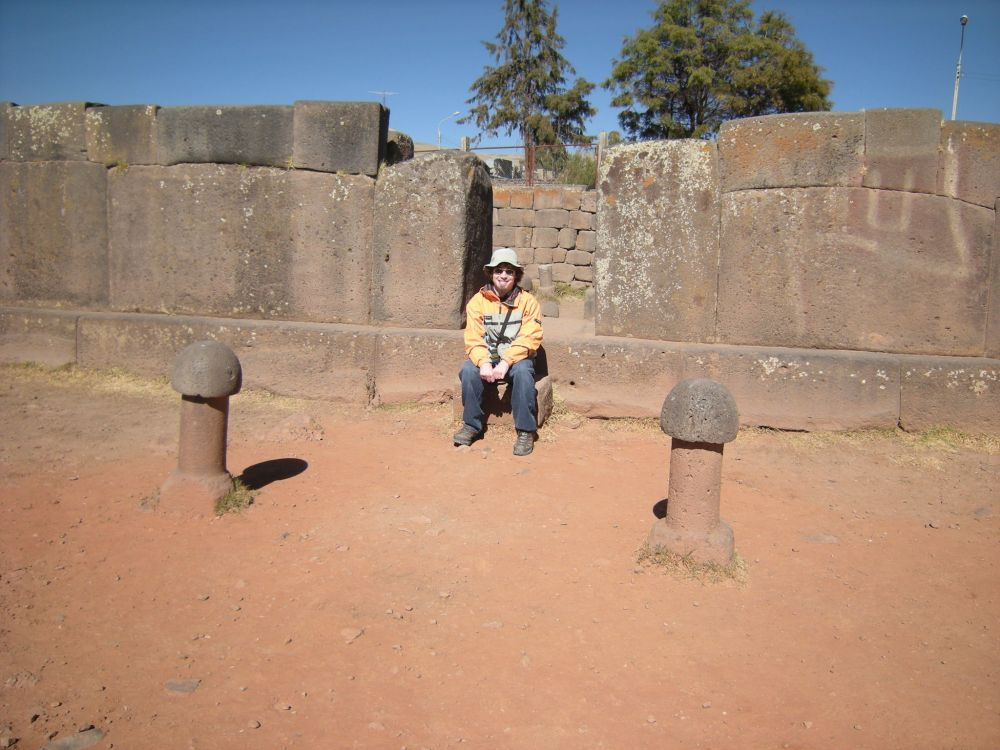 My son flanked by male fertility stones.