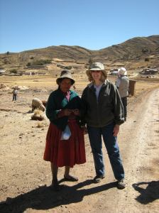 Me posing with a farm woman in typical dress.