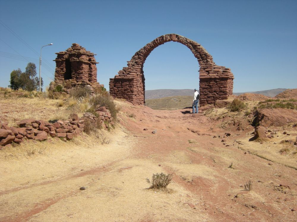Charley is standing next to the arch, at the top of the path.