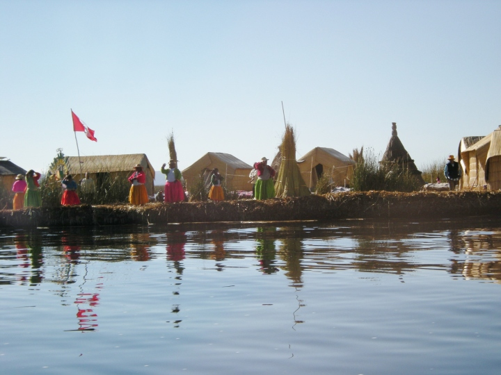 The main island: Uros women stand along the water's edge to greet us.