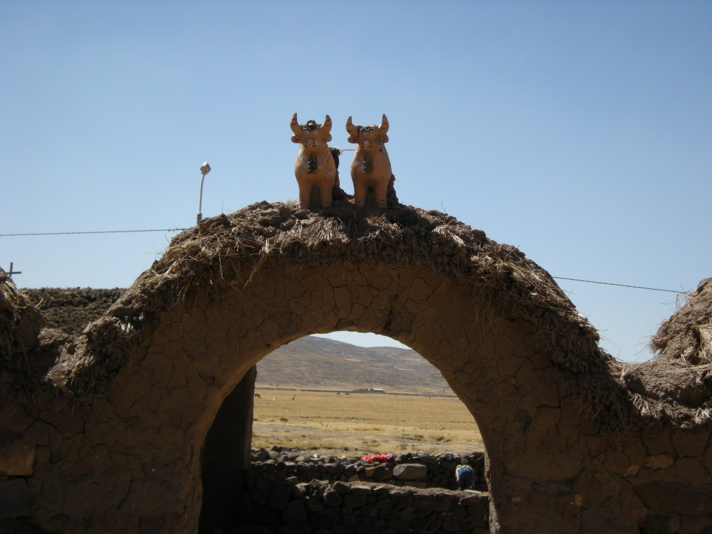 On top of the archway are two bulls, placed there for good luck. This is typical on traditional farms.