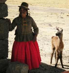Here she poses with a baby llama, or possibly a vicuna!