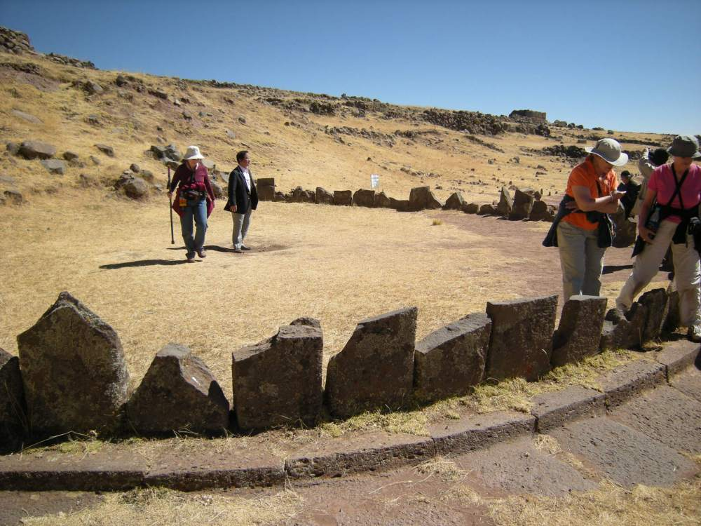 A semi circle of stones surround a spiritual spot. There are two or three of these on the site.