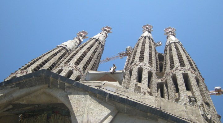 Looking up toward the tall spires that rise above any other structure in Barcelona.