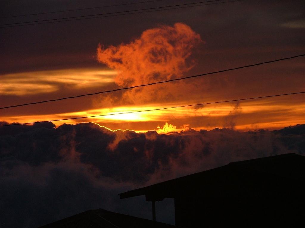 Fiery sunset over Maui, seen above the clouds on Haleakala.