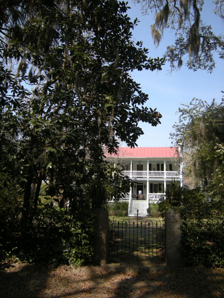 """Elixabeth Hext House (c. 1805-1825) """"Riverview"""" boasts varied flower gardens and a large kumquat tree (at left)"""