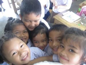 teacher-kids hanging on