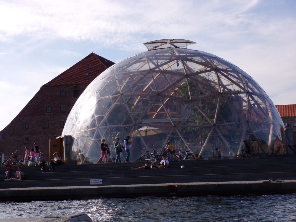 Domed greenhouse and Copenhagen residents on foot and bikes