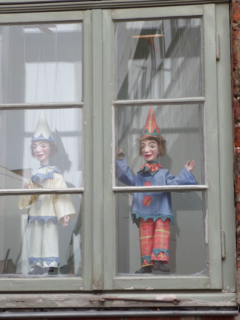 A different puppet decorated each window.