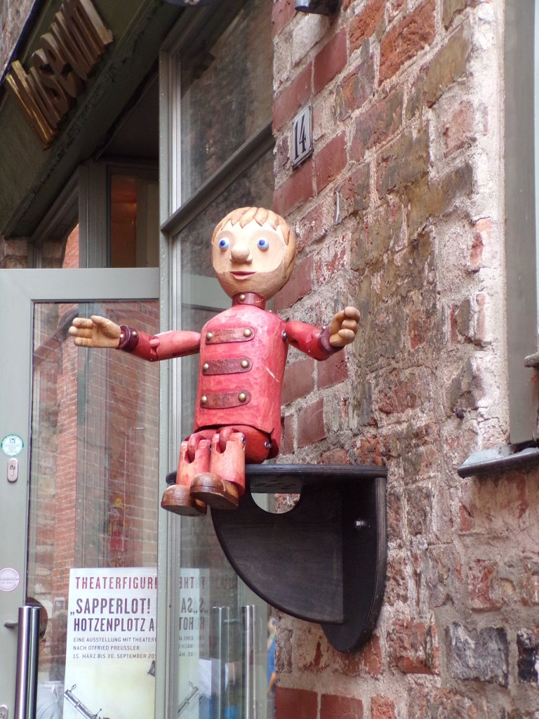 Above the doorway of the puppet museum was this cute little guy!