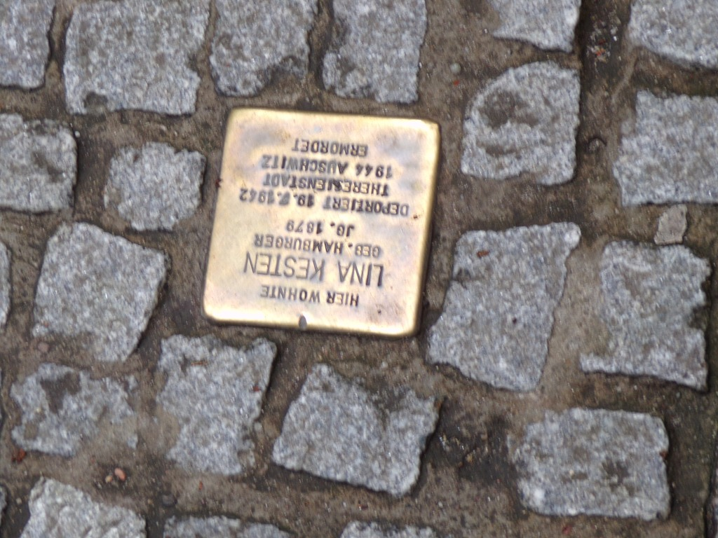 This plaque remembers Lina Kesten, a Jewish woman who was born in Hamburg but lived near this spot in Lubeck when she was deported to Auschwitz, where she died. Apparently similar commemorative plaques can be found in Berlin.