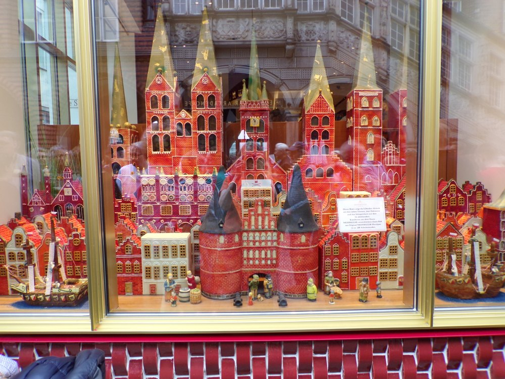 Display case at Niederegger's contains a village made of marzipan.