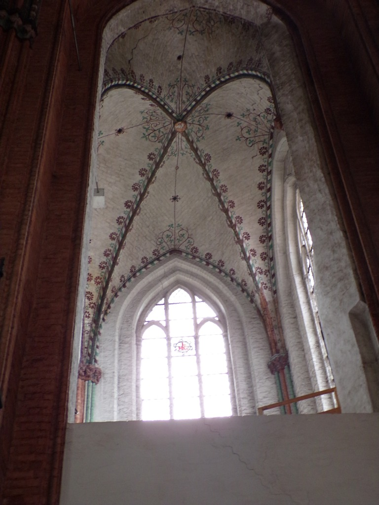 The walls and ceiling were decorated with painted designs.