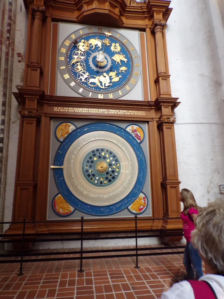 Note the signs of the zodiac on the top portion of the clock. The bottom half contains a lot of information not found on regular clocks, including the phases of the moon.