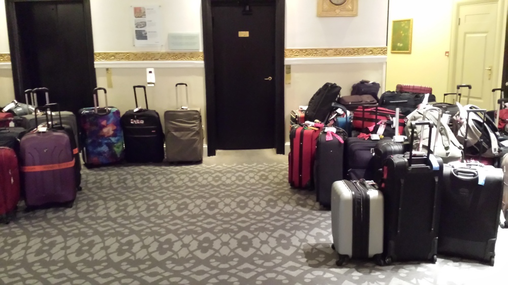 On the second floor near the elevators was the collected luggage of the cruisers from that floor. Downstairs in the lobby, the amassed luggage took up nearly the entire space!