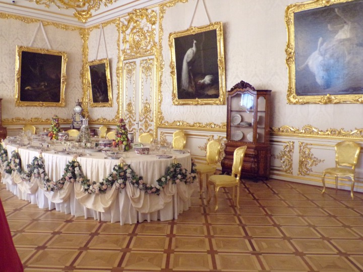 Formal dining room - the paintings on the wall depict animals having killed and are preparing to eat their prey. These gruesome images were supposed to increase the diners' appetites!