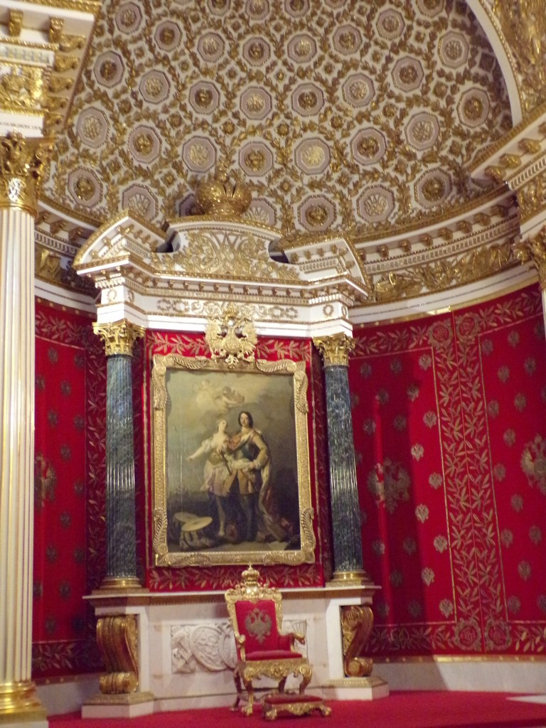 Note the insignia on the throne and above the painting: it is a two-headed eagle, one of the symbols of the Russian royal family.