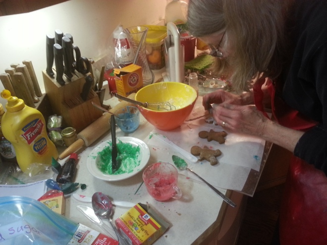 Applying icing to gingerbread boys.