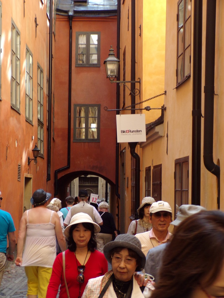 The narrow streets of Old Town were crowded with tourists.
