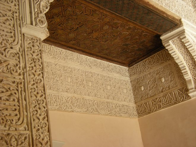 """A sentence in Arabic """"There is no victor but Allah"""" is repeated hundreds of times along with other repeated designs on ceramic tiles in The Throne Room of La Alhambra."""