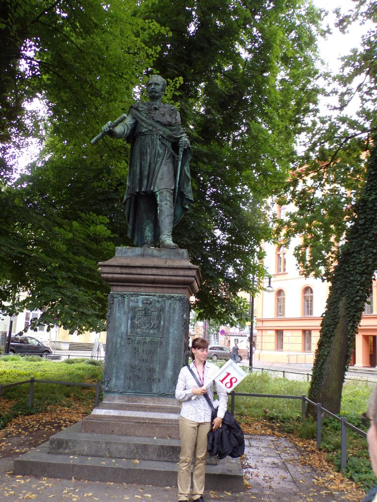Juliana waits for our tour group to gather in front of the statue of Gebhardt von Blucher.