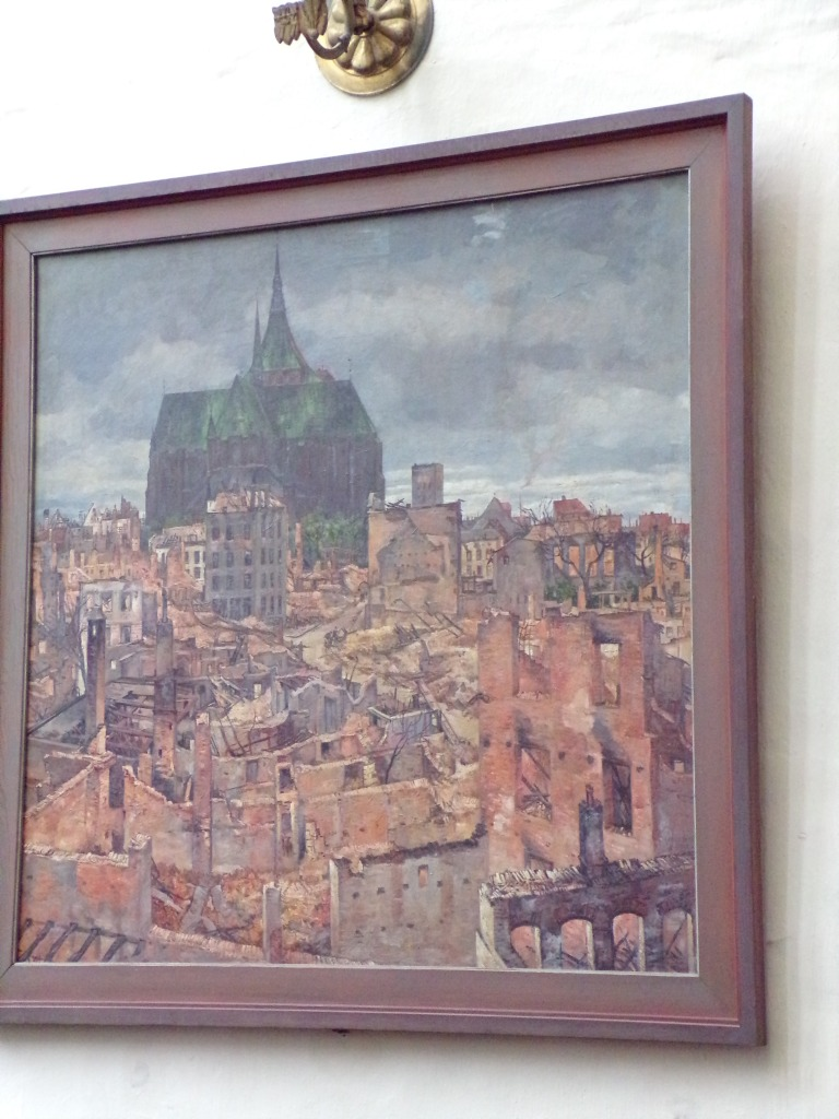 Painting depicting Rostock's center in ruins after Allied bombing, but St. Mary's Church was left intact.