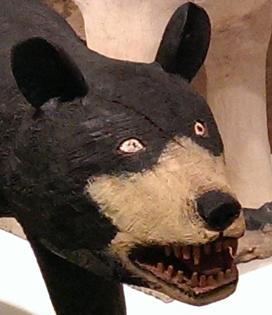"Oso (painted wood, rubber claws); Toro (painted cement, iron) - Felipe Archuleta - (NM, USA). He was a carpenter; had a vision that the Lord told him to ""carve wood"" so he began a productive career as an artist, carving a menagerie of animals."