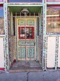 Bottle caps highlight this doorway.