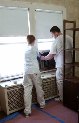 Chris & Mateusz take out the air conditioner in the dining room - never done since we've lived here!