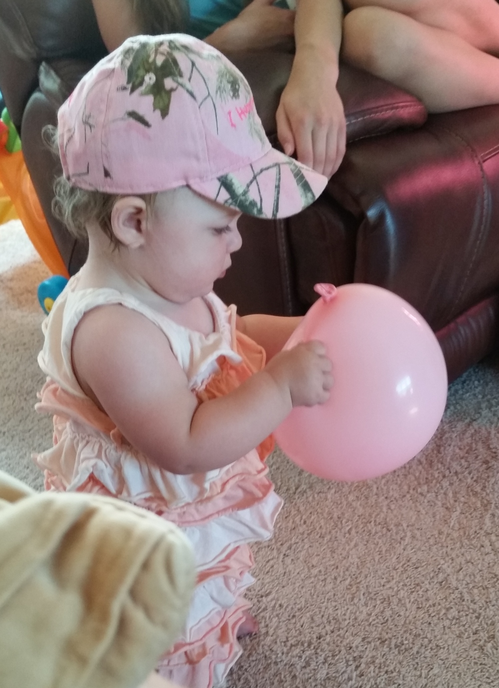 Rosemary explores a balloon - the texture, how she can pull its 'skin' apart