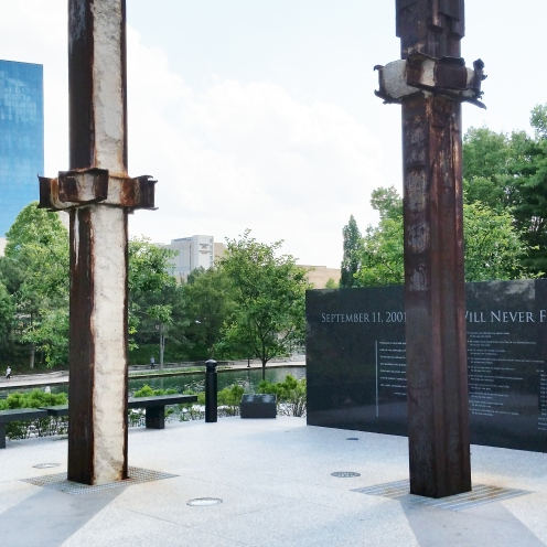 9-11 memorial. These are two pieces of the Twin Towers. The canal walk provides easy access to this monument, with a curved walkway up a small hill.