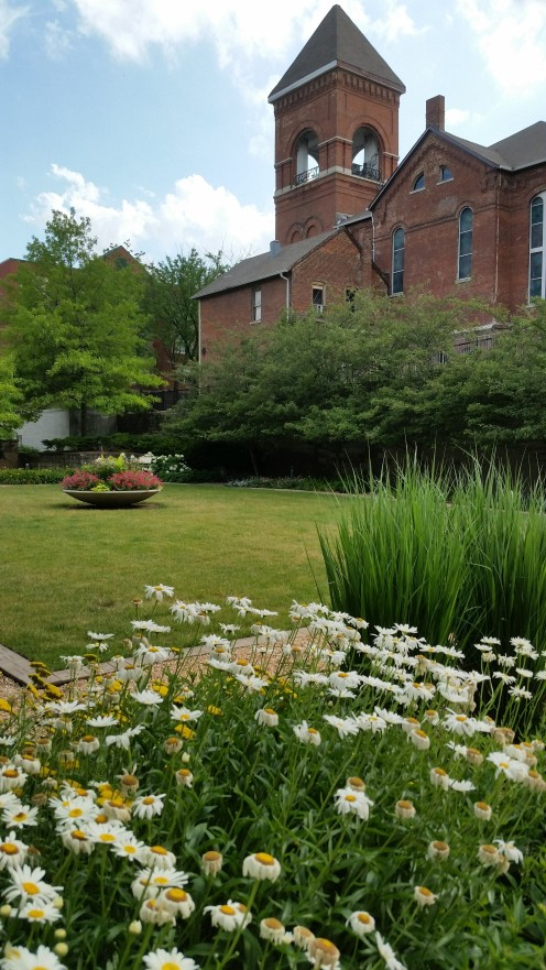 This pretty landscaped yard is for use of the public to exercise. Group yoga sessions are held here, for example.