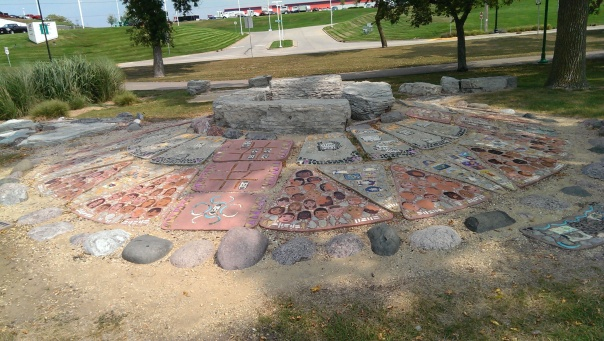 Longer view of turtle's shell - there are repeated sections of faces - perhaps those of the students who worked on it. (Many have been destroyed, possibly by exposure to the elements for 10 years).