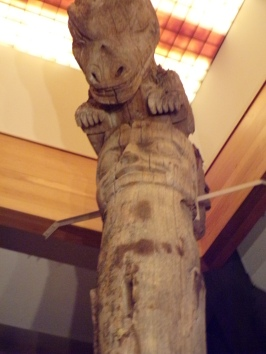 Dinosaur at the top of a totem pole??