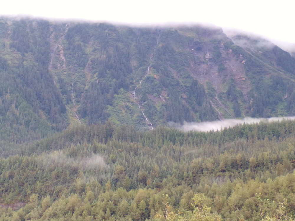 A ribbon of glacier-fed water trickles down the mountain.